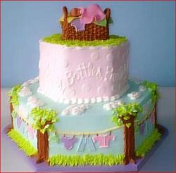 Baby shower cake with wooden basket topper and tree and clothelines decor.jpg