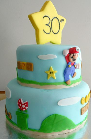 Two tier Super Mario brothers birthday cake for 30th birthday.JPG
