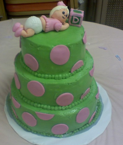 Dark green Baby Girl Shower Cake with pink dots and baby girl cake topper looking so cute.PNG