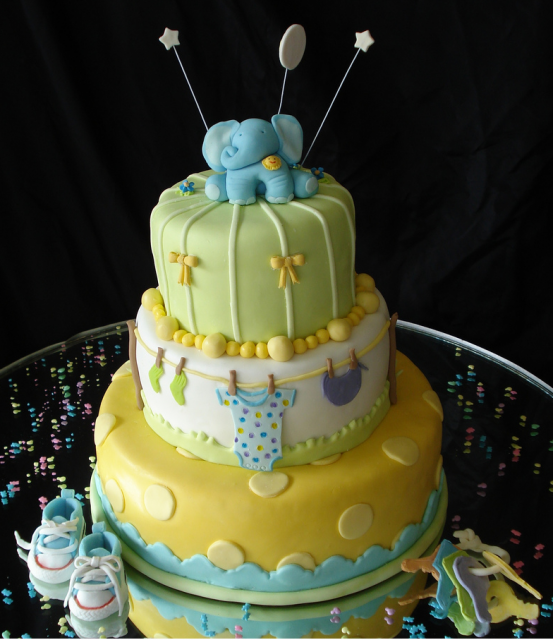 Elephant baby shower cake in bright colors.