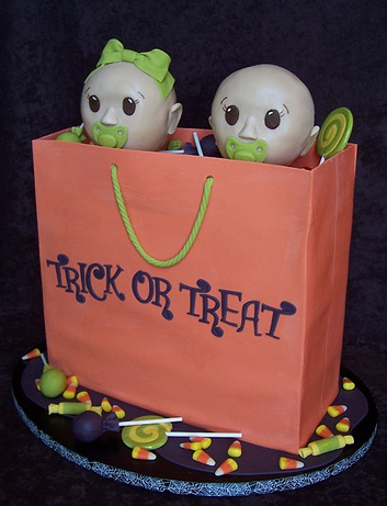 halloween baby shower cake with two babies inside a trick or treat bag
