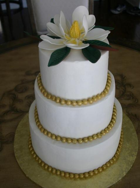 wedding cakes with beads three tier wedding cake with gold pearl and magnolia 25977