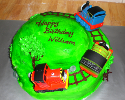 Very green cake with Thomas the train and friends.PNG