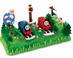 Train cake toppers with green cakes.PNG