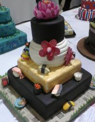 Four tier sushi theme cake.JPG