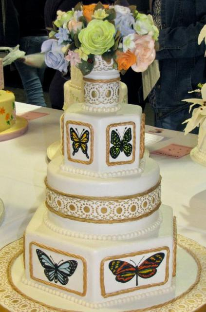 Multiple tier butterfly theme wedding cake with fresh colorful flowers on top.JPG