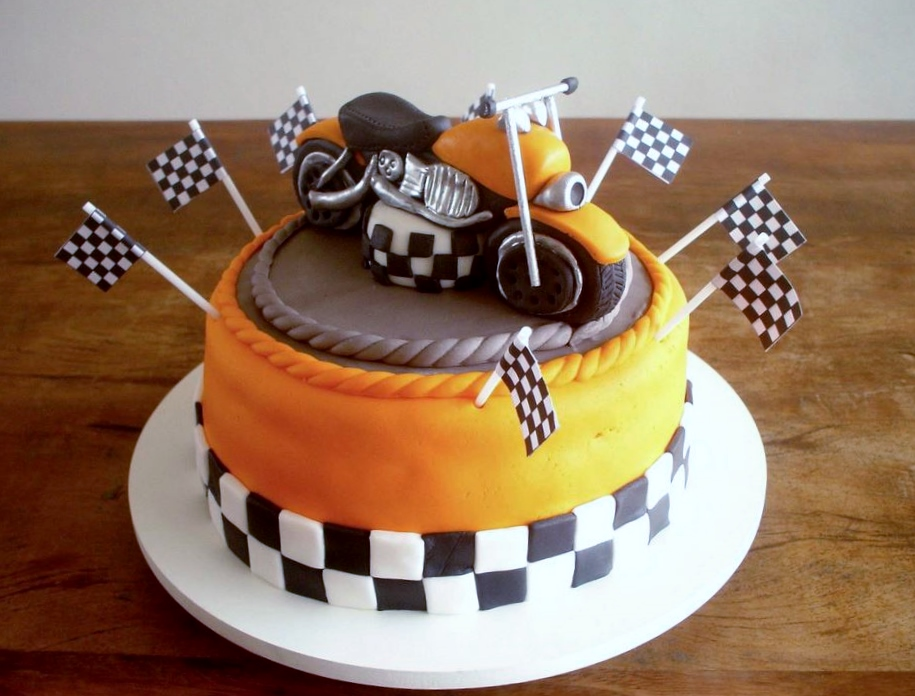 Motorcycle bike racing theme orange & chocolate cake.JPG