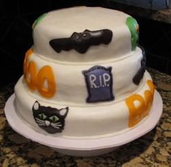 Three tier Halloween theme cake with bat cat and tombstone and boo.JPG