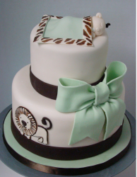 Safari baby shower cake in white, light green and dark brown with baby topper.PNG