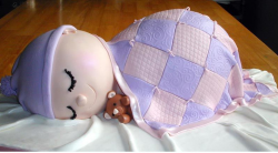 Sleeping baby baby cake in purple and light pink.PNG