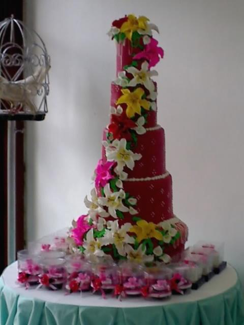 beautiful wedding cake with lots of flowers