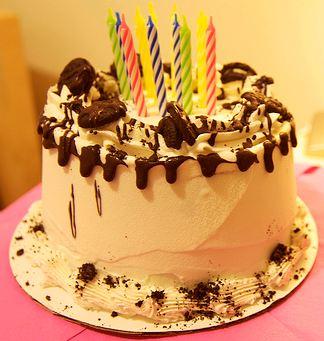 Chocolate cream birthday cake with 8 candles.JPG