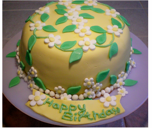 Photo of Summer home made birthday cake in yellow w/ green cake decor