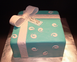 Tiffany Blue Birthday Cake in blue with big white ribbon bow.PNG
