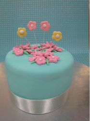 Blue cute mother's day cake with floral topper decor.PNG