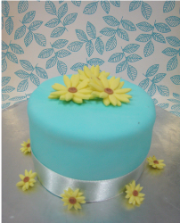Blue Mother's Day Cake with yellow flowers.PNG