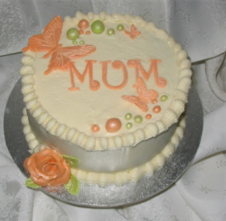 Creamy Happy Mother's Day cake with orange cake decor.PNG