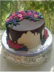 Elegant Happy Mother's Day cake with chocolate decor.PNG