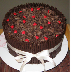 Happy chocolate Mother's Day Cake with red hearts candies.PNG