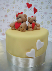 Happy Mother's Day cake with bears holding hearts on the top.PNG