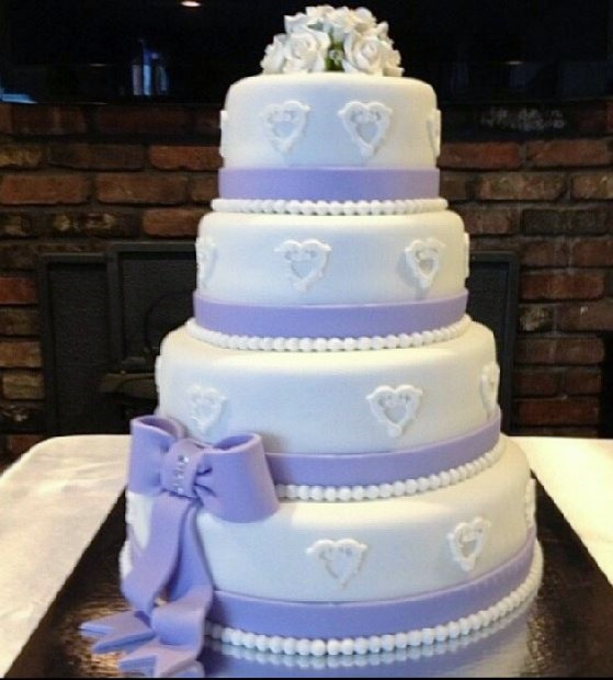 sainsburys wedding cake tier large 4 tier wedding cake in white with large lavender bow 19629