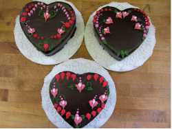 Heart shaped chocolate mother's day cakes with floral cake decor ideas.PNG
