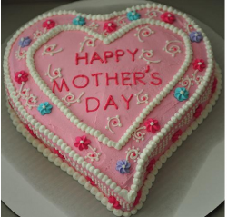 Home made heart mother's day cake with full of live cake decor.PNG