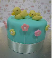Mother's Day Cake with yellow ducks on the top and flowers.PNG