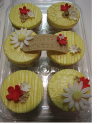 Mother's Day Cupcakes in yellow with red and daisy flowers.PNG