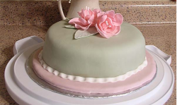 Mother's Day Fondant Cake with light pink flowers topper.PNG
