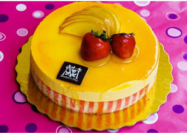Picture of mango mousse Mother's Day cake with strawberries topper.PNG