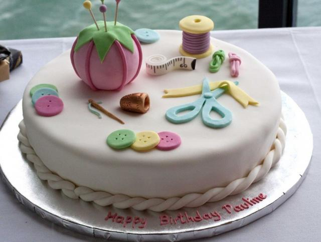 Ivory round white sewing theme birthday cake.JPG