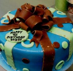 Blue round birthday cake with chocolate bow.JPG