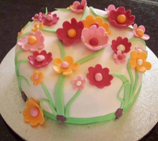 White round birthday cake with many flower petals.JPG (1 comment)