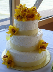 Picture of fall wedding cake topper with fresh yellow flowers.PNG