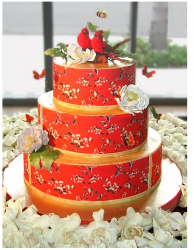 Red wedding cake with nature cake topper.PNG