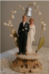 Traditional wedding cake toppers with flowered arch with silver bell.PNG