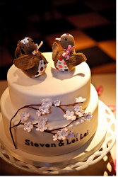 Two brown birds wedding cake toppers image.PNG