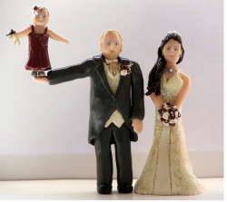 Unique cake topper of Bride and Groom and Acrobatic Flower Girl.PNG