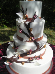 Very chic wedding cake with bloom tree theme.PNG