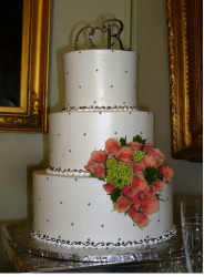 Wedding cake with initial wedding cake topper.PNG