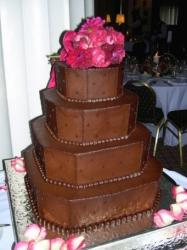 chocolate square wedding cake in four tier with bright pink flowers