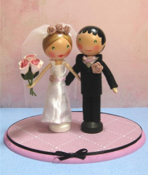 Wooden bride and groom cake toppers.PNG