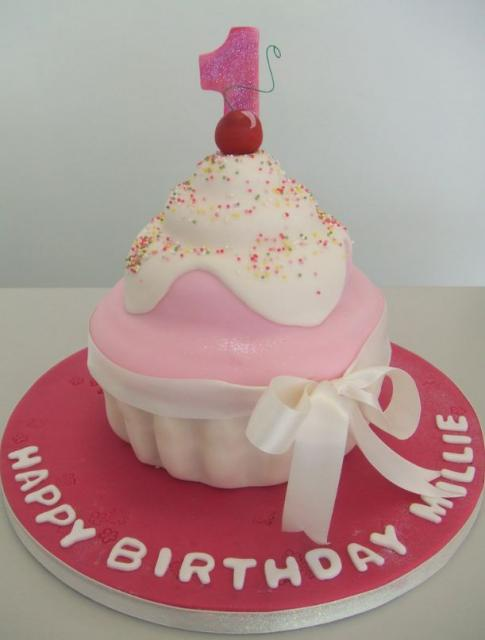 Giant pink cupcake birthday cake for one-year-old.JPG