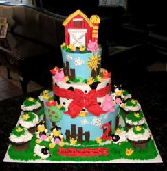 Three level farm theme cake with matching cupcakes.JPG