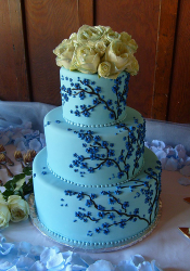 Bright blue wedding cake with dark bloom flower tree with fresh floral wedidng cake topper picture.PNG