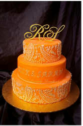 Bright orange wedding cake with crystal cake topper.PNG