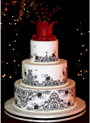 Big fancy wedding cake with red unique cake topper.PNG