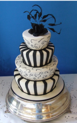 Black and white wedding cake with fake black rose with black feathers.PNG