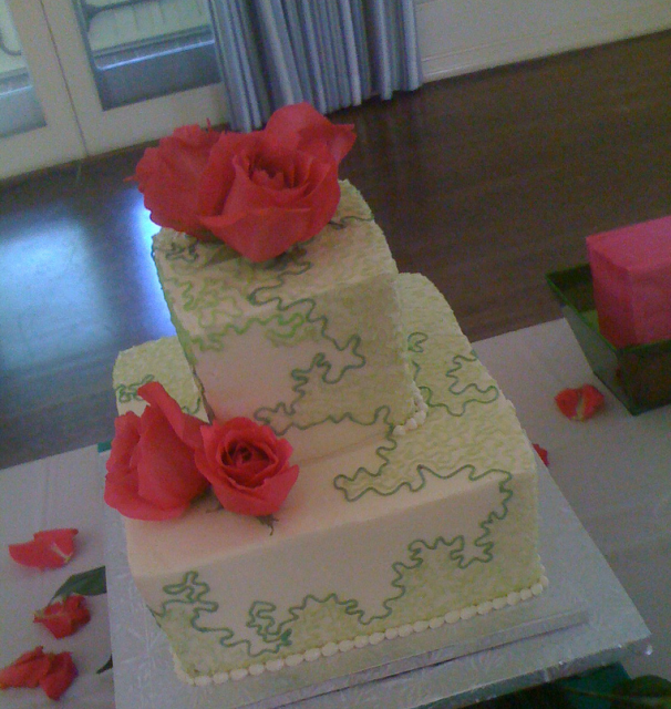 Elegant and chic square wedding cake with fresh bright pink roses.PNG